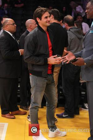 Roger Federer - Celebrities at the Los Angeles Lakers game. The Atlanta Hawks defeated the Los Angeles Lakers by the...