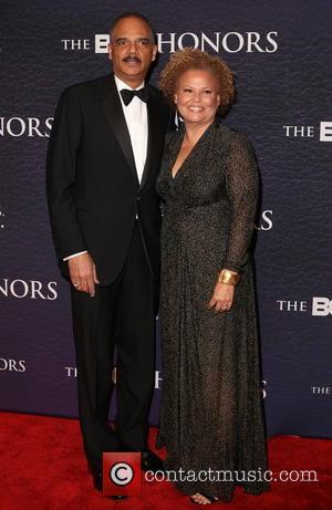Eric Holder and Debra Lee