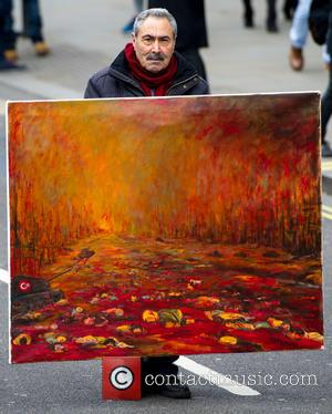 Kaya Mar With His Painting 'massacre Of The Kurds'