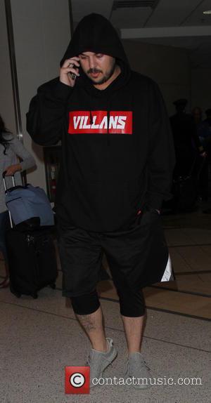 Rob Kardashian - Rob Kardashian arrives at Los Angeles International Airport with girlfriend Blac Chyna - Los Angeles, California, United...