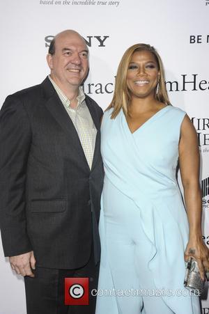 John Carroll Lynch and Queen Latifah