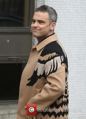 Robbie Williams 'Paid $2.1 Million' To Sing At Oligarch's Wedding