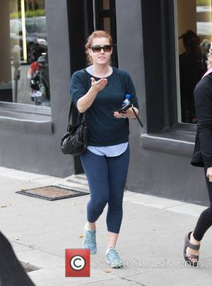 Amy Adams - Amy Adams spotted out shopping in Beverly Hills, driving an Audi that has two different license plates...