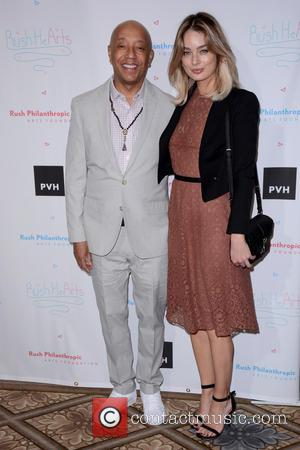 Russell Simmons and Lucy Mcintosh