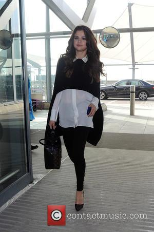 Selena Gomez - Selena Gomez arriving at Heathrow Airport, following a whirlwind 15hr visit to London. Selena even made time...