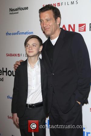 Jaeden Lieberher and Clive Owen