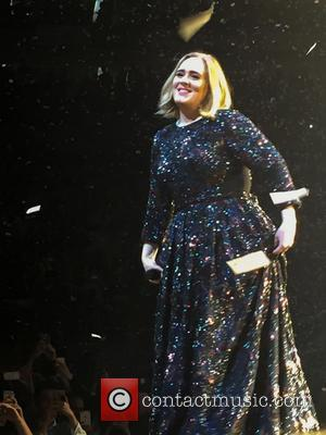 Adele Honours Slain Belgians At London Gig