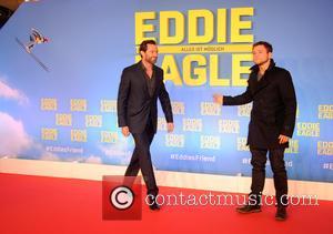 Hugh Jackman and Taron Egerton