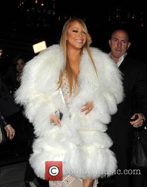 Mariah Carey's Awkward Onstage Lap Dance