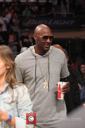 Lamar Odom - Celebrities at the Los Angeles Lakers game.The Los Angeles Lakers defeated the Miami Heat by the final...
