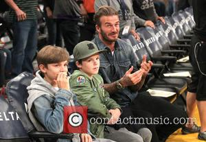 David Beckham, Romeo Beckham , Cruz Beckham - Celebrities watch the Boston Celtics defeat the Los Angeles Lakers at The...