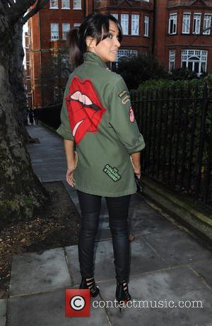 Jackie St Clair - Jackie St Clair poses for pictures wearing a Rolling Stones jacket whilst on her way to...