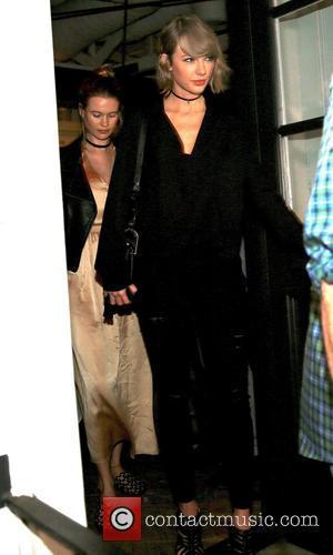 Behati Prinsloo and Taylor Swift