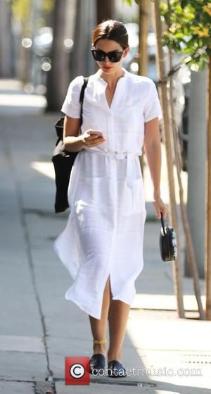 Lily Aldridge - Lily Aldridge leaves the gym in LA wearing a flowing white dress - Los Angeles, California, United...