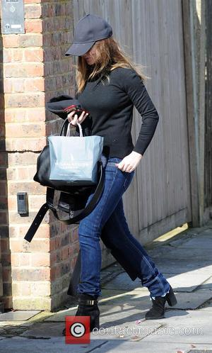 Geri Horner , Geri Halliwell - Geri Horner arrives home in baseball cap and jeans - London, United Kingdom -...