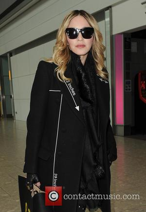 Madonna - Madonna arriving at Heathrow Airport - London, United Kingdom - Thursday 7th April 2016