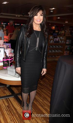 Marie Osmond - Marie Osmond signs copies of her new CD 'Music Is Medicine' at the Promenade Gift Shop inside...