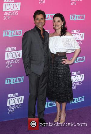 John Stamos and Paget Brewster