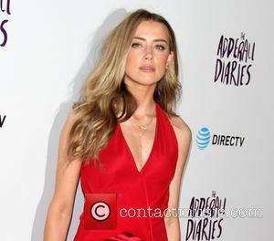 Amber Heard's Bruises Came From Saturday Night Fight - Report