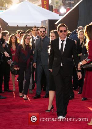 Chris Evans, Susan Downey and Robert Downey Jr.