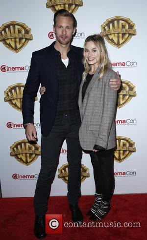 Alexander Skarsgard , Margot Robbie - 2016 CinemaCon Warner Bros Pictures Red Carpet Arrivals at Caesar's Palace Resort and Casino...