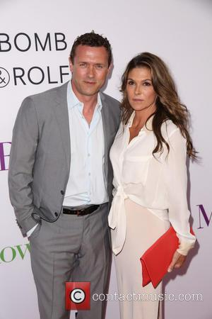 Jason O'mara and Paige Turco