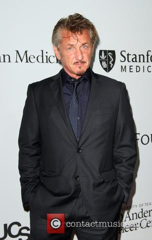 Sean Penn Makes Red Carpet Debut With New Girlfriend