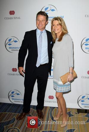 Billy Bush and Vanna White
