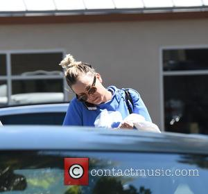 Kaley Cuoco - Kaley Cuoco takes a phone call while leaving her yoga class - Los Angeles, California, United States...