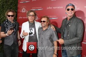Daxx Nielsen, Tom Petersson, Michael Anthony and Chad Smith