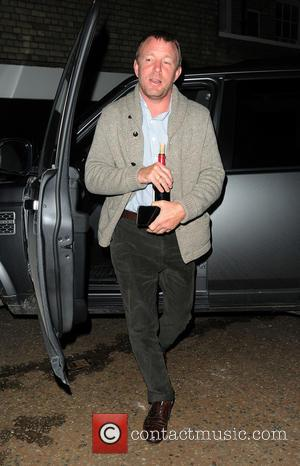 Guy Ritchie - Guy Ritchie arriving at Madonnas home, just after 9pm, with a corked bottle of wine. Guy left...
