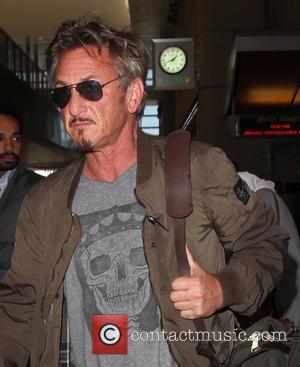 Sean Penn - Sean Penn leaves on a flight for Paris from Los Angeles International Airport - Los Angeles, California,...