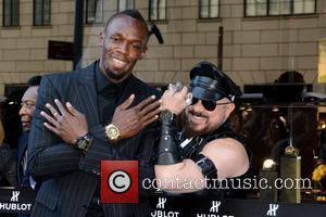 Usain Bolt and Peter Marino
