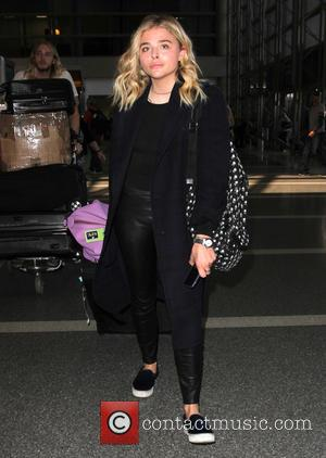 Chloe Grace Moretz - Chloe Grace Moretz arrives at Los Angeles International (LAX) Airport - Los Angeles, California, United States...