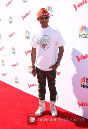 Pharrell Williams Surprises Kids At New York School