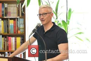 Anderson Cooper - Anderson Cooper signs copies of his new book 'The Rainbow Comes and Goes' at Book Revue in...