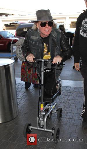 Axl Rose - Axl Rose arrives at Los Angeles International Airport - Los Angeles, California, United States - Monday 25th...