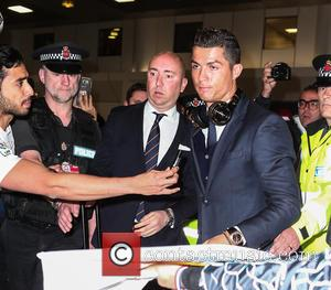 Cristiano Ronaldo - Real Madrid arrive at Manchester Airport ahead of their Champions League semi-final against Manchester City - Manchester,...