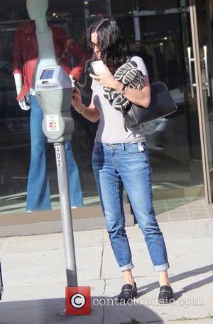 Courteney Cox - Courteney Cox running errands in Beverly Hills at beverly hills - Beverly Hills, California, United States -...