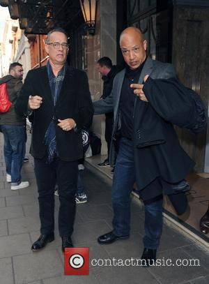 Tom Hanks - Tom Hanks leaving his hotel. As he makes his way to a waiting car, one of the...