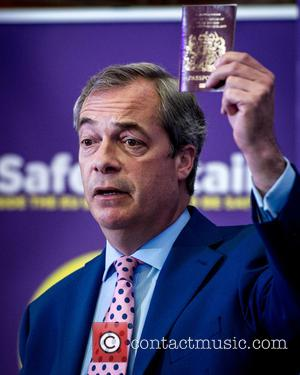 Nigel Farage , Leader of the UK Independence Party (UKIP) - UKIP leader Nigel Farage brandishes a Passport during his...