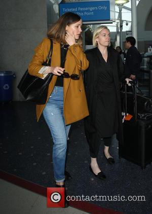 Rose Byrne - Rose Byrne arrives at Los Angeles International Airport (LAX) - Los Angeles, California, United States - Friday...
