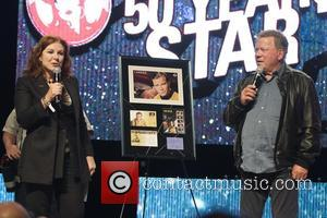 William Shatner - William Shatner is presented with a Commemorative stamp collection from Canada Post celebrating 50 Years of Star...