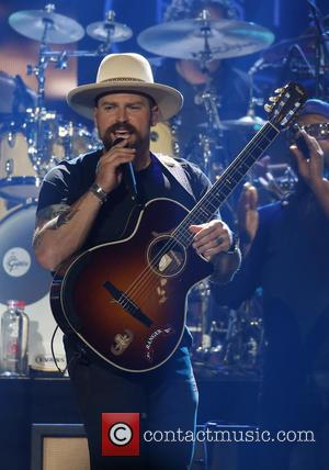 Zac Brown Buys Prize Steer At Auction