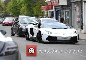 Megan Mckenna - Megan Mckenna arrives in a lamborghini to open the new Strawberry Glow salon in Chingford. - Chingford,...