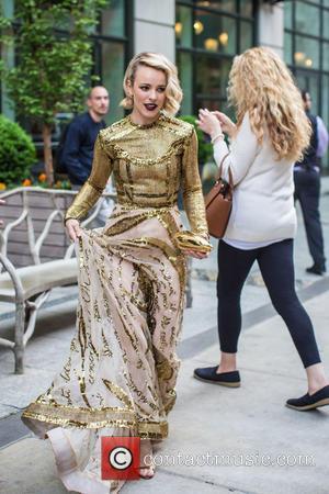 Rachel McAdams - Rachel McAdams wears a gold mesh dress and dark purple lip as she makes her way to...