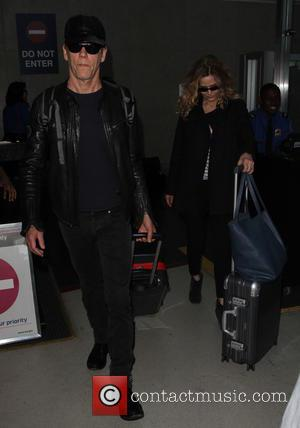 Kevin Bacon , Kyra Sedgwick - Kevin Bacon and Kyra Sedgwick arrive at Los Angeles International Airport - Los Angeles,...