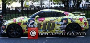 Nissan GT R - An emoji wrapped Nissan GT R competes in the 2016 Gumball 3000 in London - London,...