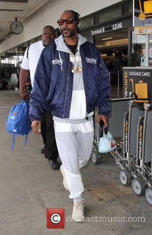 Snoop Lion , Snoop Dogg - Snoop Dogg arrives at Los Angeles International (LAX) Airport - Los Angeles, California, United...