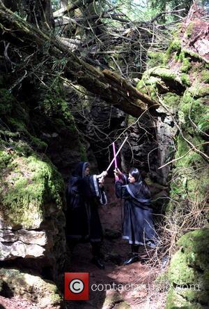 Farahziya Ziya , Dan Walton - Farahziya Ziya and Dan Walton of the Star Wars Lightsaber Combat Academy act out...
